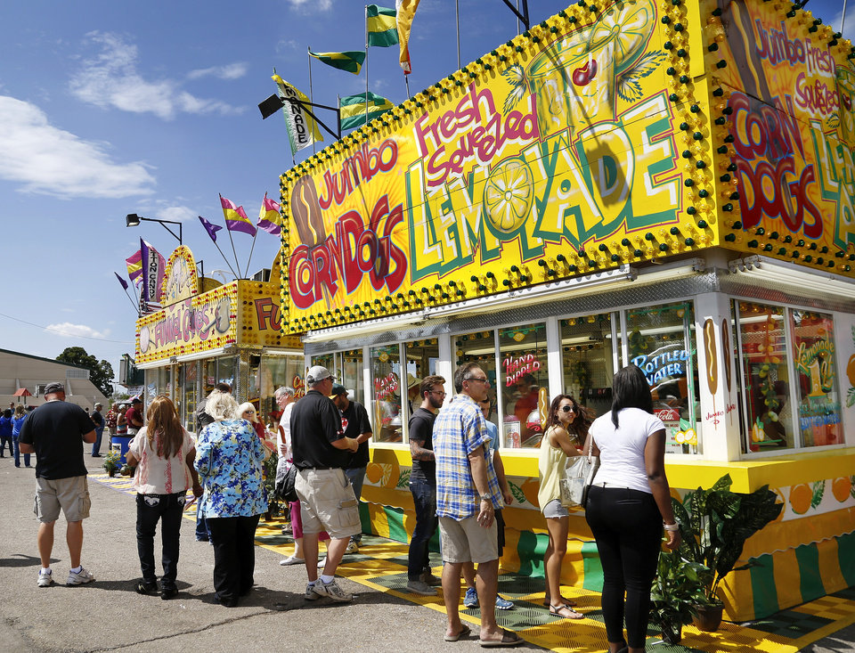 Photo - Fairgoers line up to buy corn dogs at the Oklahoma State Fair on Wednesday, , Sep. 18, 2013. Photo  by Jim Beckel, The Oklahoman.