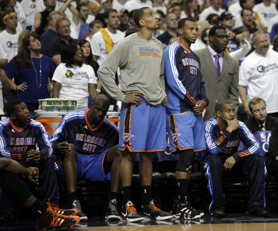 Photo - Oklahoma City Thunder players watch during the final moments of their overtime loss to the Memphis Grizzlies in Game 3 of a second-round NBA basketball series on Saturday, May 7, 2011, in Memphis, Tenn. The Grizzlies won 101-93 in overtime to take a 2-1 lead in the series. From left are Nate Robinson, Nazr Mohammed, Thabo Sefolosha, Daequan Cook, and Eric Maynor. (AP Photo/Lance Murphey)
