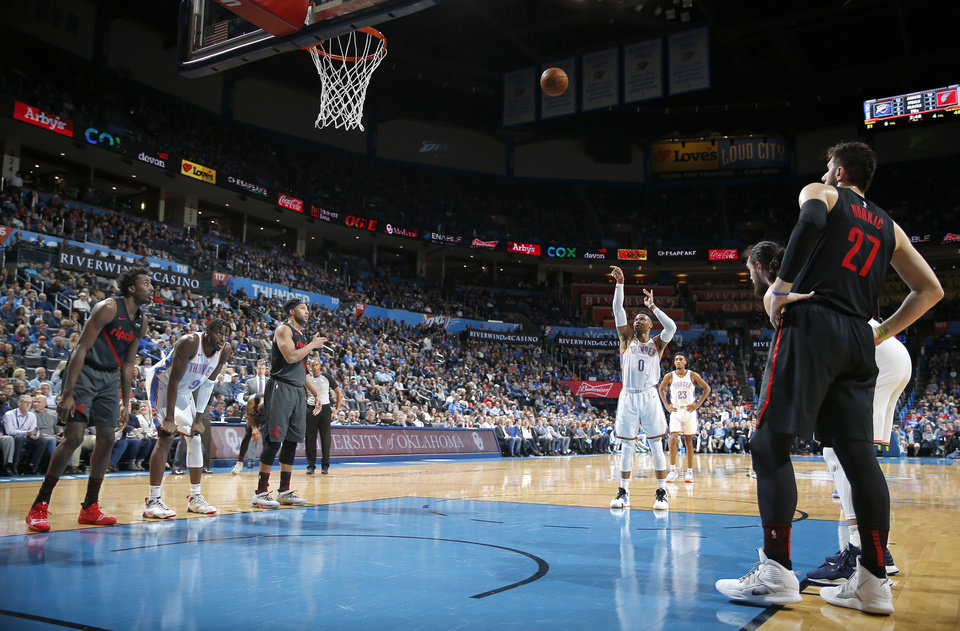 Photo - Oklahoma City's Russell Westbrook (0) shoot a free throw during the NBA basketball game between the Oklahoma City Thunder and the Portland Trail Blazers at Chesapeake Energy Arena in Oklahoma City, Tuesday, Jan. 22, 2019. Photo by Sarah Phipps, The Oklahoman