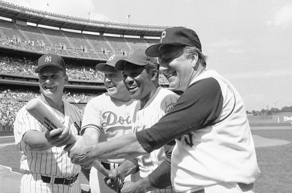 Photo - FILE - In this Augt. 23, 1980 file photo, Hall of Famers from left, Roger Maris, Duke Snider, Willie Mays and Ralph Kiner, pose for pictures before the annual New York Mets Old Timers Day at Shea Stadium in New York. The baseball Hall of Fame says slugger Ralph Kiner has died. He was 91. The Hall says Kiner died Thursday, Feb. 6, 2014, at his home in Rancho Mirage, Calif. (AP Photo/File)