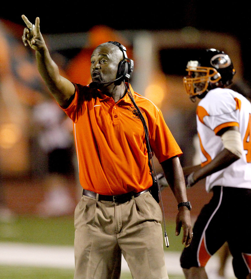 Photo - Booker T. Washington coach Darrell Hall shouts instructions during a high school football game against Carl Albert in Midwest City, Okla., Friday, September 3, 2010.  Photo by Bryan Terry, The Oklahoman