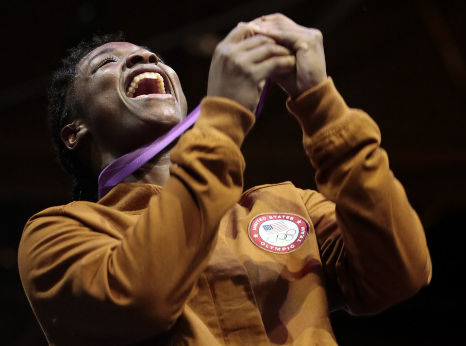 Photo -   FILE - In this Aug. 9, 2012 file photo, boxing gold medalist Claressa Shields, of the United States, reacts during the medal ceremony at the 2012 Summer Olympics,in London. Unwilling to accept a life of poverty, crime or worse, Shields found her family, her passion and her way out through a small, dark basement gym. (AP Photo/Ivan Sekretarev, File)