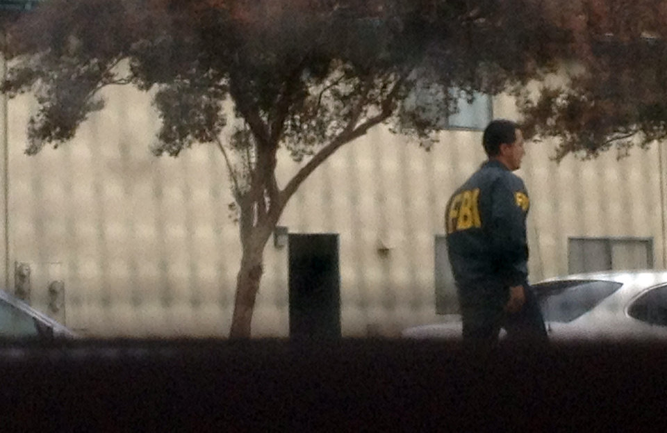 This provided photo taken Friday, Nov. 16, 2012, by Jenny Collins from her neighbor's window shows law enforcement and FBI agents during a raid at the home of 21-year-old Miguel Alejandro Santana Vidriales of Upland, Calif. Santana was one of four Southern California men charged with plotting to kill Americans and destroy U.S. targets overseas by joining al-Qaida and the Taliban in Afghanistan, federal officials said Monday. In one online conversation, Santana told an FBI undercover agent that he wanted to commit jihad and expressed interest in a jihadist training camp in Jalalabad, Afghanistan. (AP Photo/Jenny Collins)