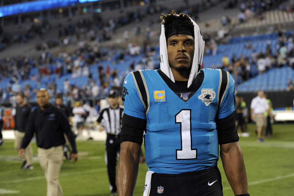 Photo - FILE - In this Sept. 13, 2019, file photo, Carolina Panthers quarterback Cam Newton (1) walks off the field following the Panthers 20-14 loss to the Tampa Bay Buccaneers in an NFL football game in Charlotte, N.C. The Panthers are parting ways with Cam Newton. Carolina general manager Marty Hurney said Tuesday, March 17, 2020, via Twitter the team is giving the 31-year-old quarterback permission to seek a trade _ although the former league MVP responded by saying he never requested one. (AP Photo/Mike McCarn, File)