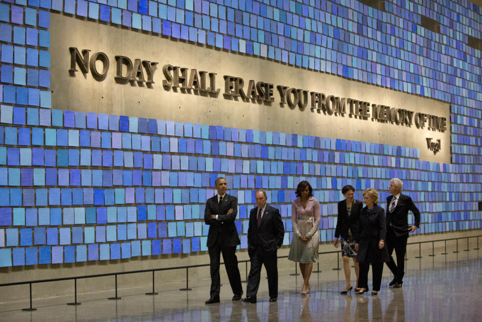 Photo - President Barack Obama, first lady Michelle Obama, former New York City Mayor Michael Bloomberg, former Secretary of State Hillary Rodham Clinton, former President Bill Clinton, and Diana Taylor, tour the Memorial Hall at the National September 11 Memorial Museum, Thursday, May 15, 2014, in New York.  (AP Photo/Carolyn Kaster)