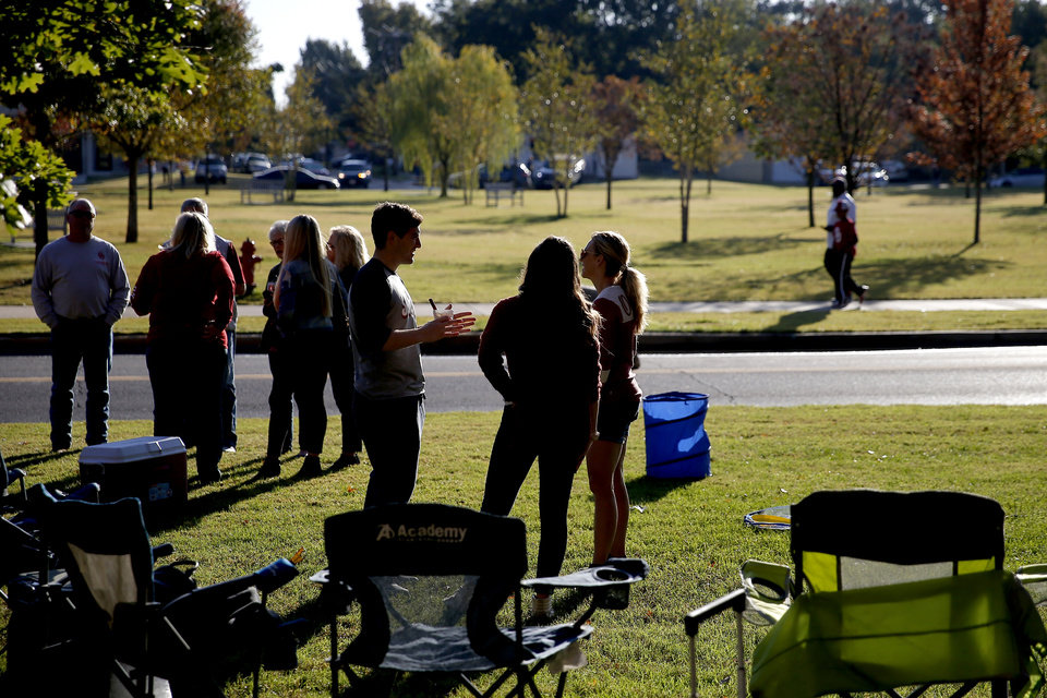 Photo - Fans tailgate before a college football game between the University of Oklahoma Sooners (OU) and the West Virginia Mountaineers at Gaylord Family-Oklahoma Memorial Stadium in Norman, Okla, Saturday, Oct. 19, 2019. [Bryan Terry/The Oklahoman]