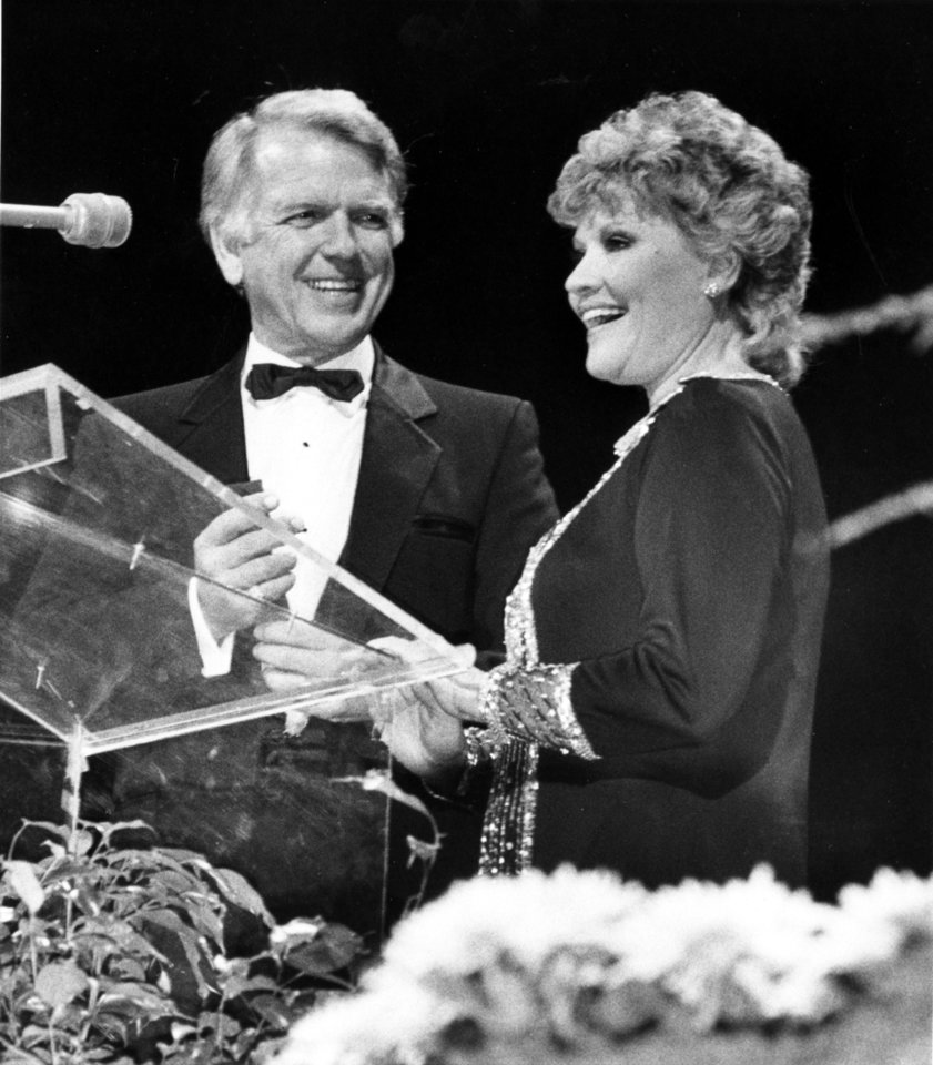 Photo - Gov. George Nigh presented Claremore native Patti Page (aka Clara Ann Fowler), the best-selling female vocalist of all times, with the medallion signifying her entrance into the Oklahoma Hall of Fame. The ceremony took place during the 76th annual Oklahoma Hall of Fame banquet held Nov. 16, 1983 in the Myriad Convention Center in downtown Oklahoma City. Oklahoman Archive photo by George R. Wilson  George R. Wilson