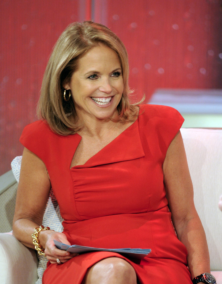 "Photo -  This Aug. 9, 2012 photo released by Disney-ABC Domestic Television shows host Katie Couric during a taping of her new talk show ""Katie."" Couric's new show will debut on Monday, Sept. 10. (AP Photo/Disney-ABC Domestic TV, Ida Mae Astute) ORG XMIT: NYET824"