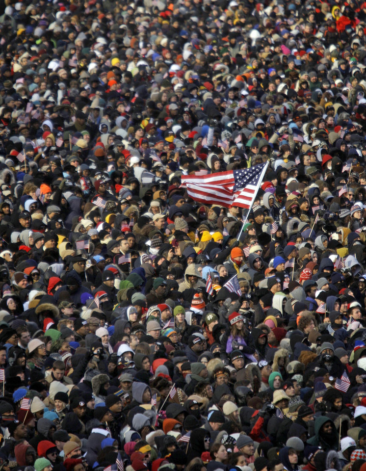 Photo - Bundled people pack the National Mall for the inauguration of President-elect Barack Obama in Washington, Tuesday, Jan. 20, 2009. (AP Photo/Carolyn Kaster)