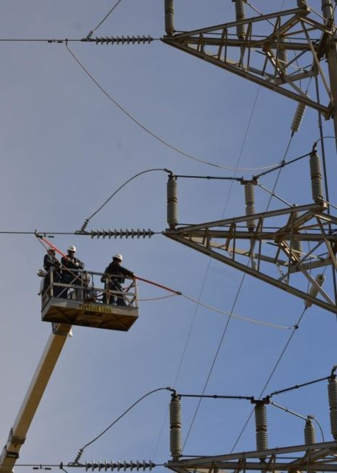Photo -  Western Farmers Electric Cooperative crews work on a switching station near Kingfisher. [PROVIDED BY WESTERN FARMERS ELECTRIC COOPERATIVE]