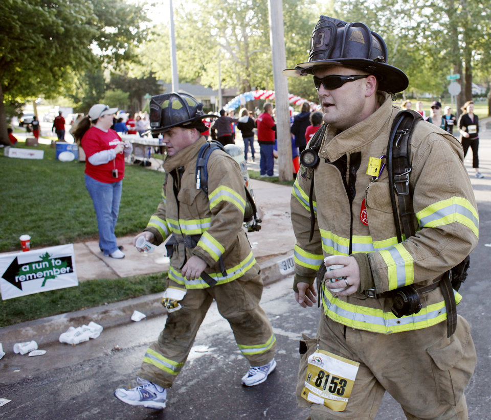 Photo - Midwest City firefighters Brian Christy and Richard Lawrence go through the race in full gear during the 10th anniversary of the Oklahoma City Memorial Marathon Sunday, April 25, 2010 in Oklahoma City. Photo by Doug Hoke, The Oklahoman. ORG XMIT: KOD