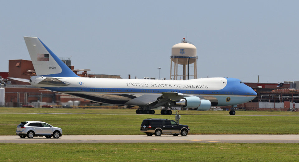 Photo -  Above: A modified Boeing 747 serving as Air Force One taxis down the runway Thursday at Tinker Air Force Base. [Photo By Steve Gooch, The Oklahoman]