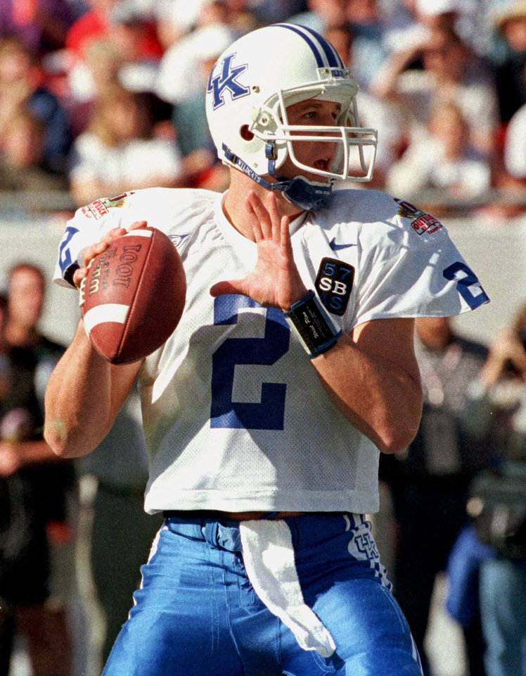 Photo - ADVANCE FOR WEEKEND EDITIONS APRIL 10-11--FILE--University of Kentucky football quarterback Tim Couch looks for an open receiver during the Outback Bowl against Penn State in this Jan. 1, 1999 photo, in Tampa, Fla. When the NFL draft begins next Saturday, Ricky Williams, Champ Bailey, Chris Claiborne and Jevon Kearse, will wait while Tim Couch, Akili Smith, Donovan McNabb and Daunte Culpepper are chosen. While the first four are the best athletes, the next four are the best quarterbacks. (AP Photo/ChrisO'Meara)