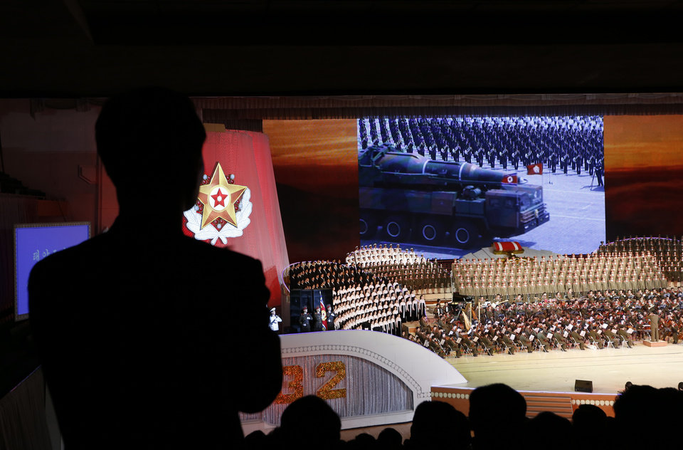Photo -   A military vehicle carrying what appears to be a new missile in a mass military parade in the Kim Il Sung Square, is seen on a screen at the gymnasium on the eve of the 80th anniversary of the founding of the North Korean army in Pyongyang, North Korea Tuesday, April 24, 2012. (AP Photo/Vincent Yu)