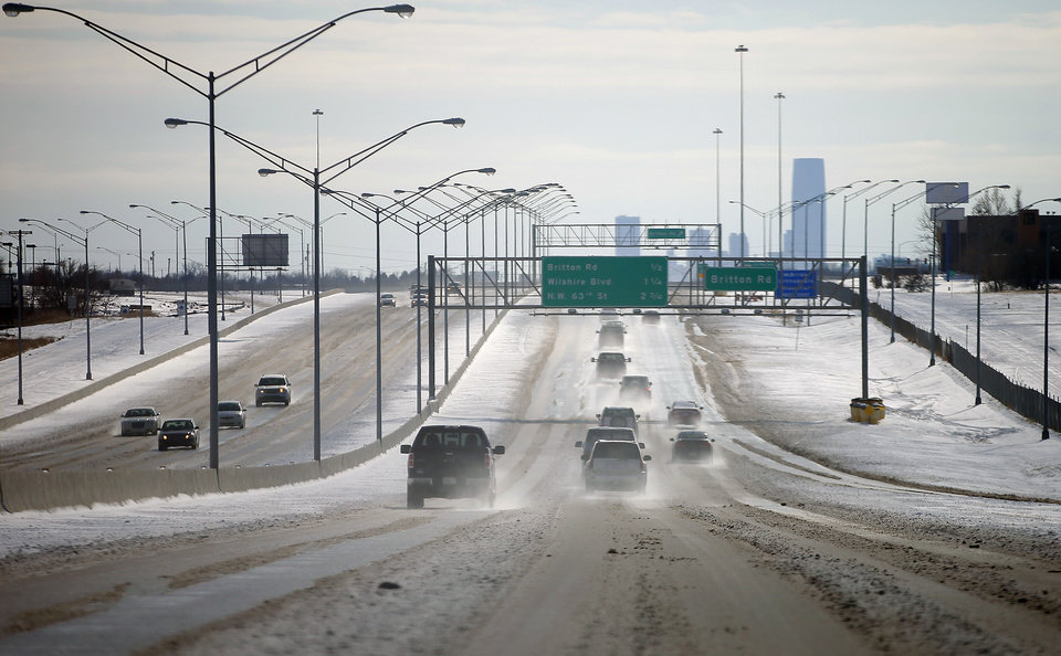 Photo - Traffic flows north as snow melts on Broadway Extension in Oklahoma City, Friday, December 6, 2013. Photo by Bryan Terry, The Oklahoman