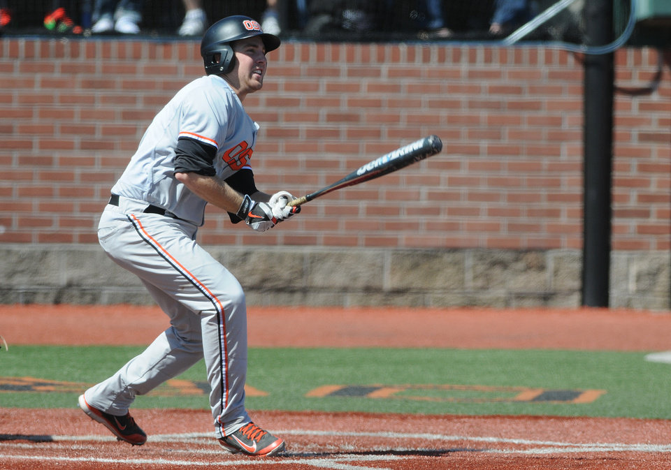 Photo - Oregon State's Kavin Keyes hits a triple against UNLV during an NCAA college baseball regional tournament game in Corvallis, Ore., Sunday, June 1, 2014. (AP Photo/Mark Ylen)