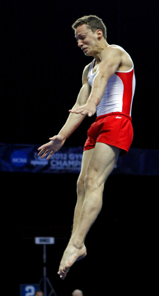 Photo - Oklahoma's Dylan Akers competes in the floor exercise at the event finals of the men's NCAA Men's Gymnastics Championships at the Lloyd Noble Center on Saturday, April 21, 2012, in Norman, Okla.  Photo by Steve Sisney, The Oklahoman