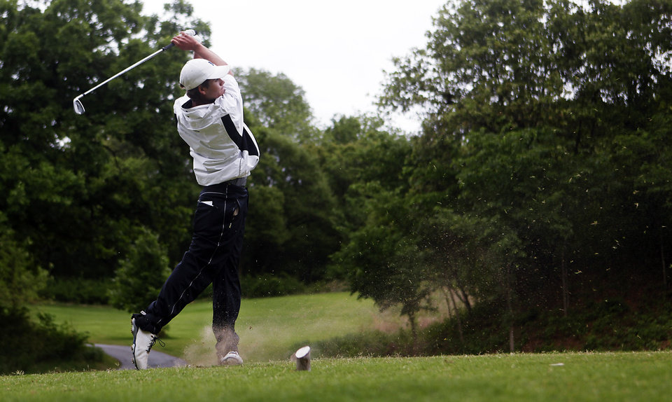 Photo - Hayden Wood of Edmond North tees off at the 6A Golf State Championship at Karsten Creek, Monday, May 12, 2014, in Stillwater. Photo by KT King, For The Tulsa World