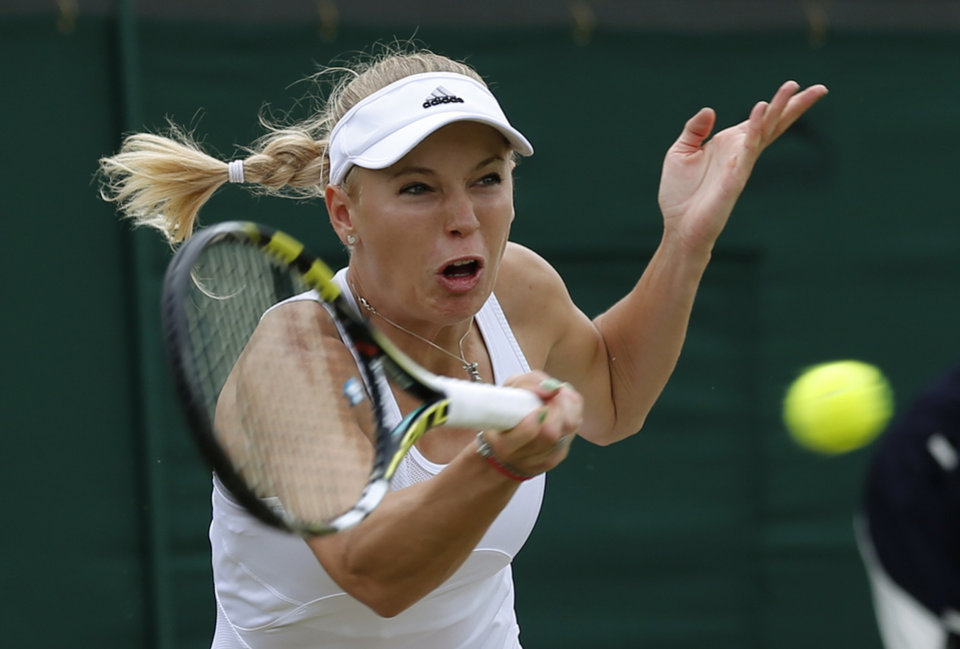 Photo - Caroline Wozniacki of Denmark plays a return to Ana Konjuh of Croatia during their women's singles match at the All England Lawn Tennis Championships in Wimbledon, London, Friday, June 27, 2014. (AP Photo/Ben Curtis)