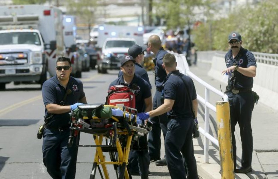 Photo -  El Paso Fire Medical personnel arrive last weekend at the scene of a shooting at a Walmart near the Cielo Vista Mall in El Paso, Texas. [AP PHOTO]
