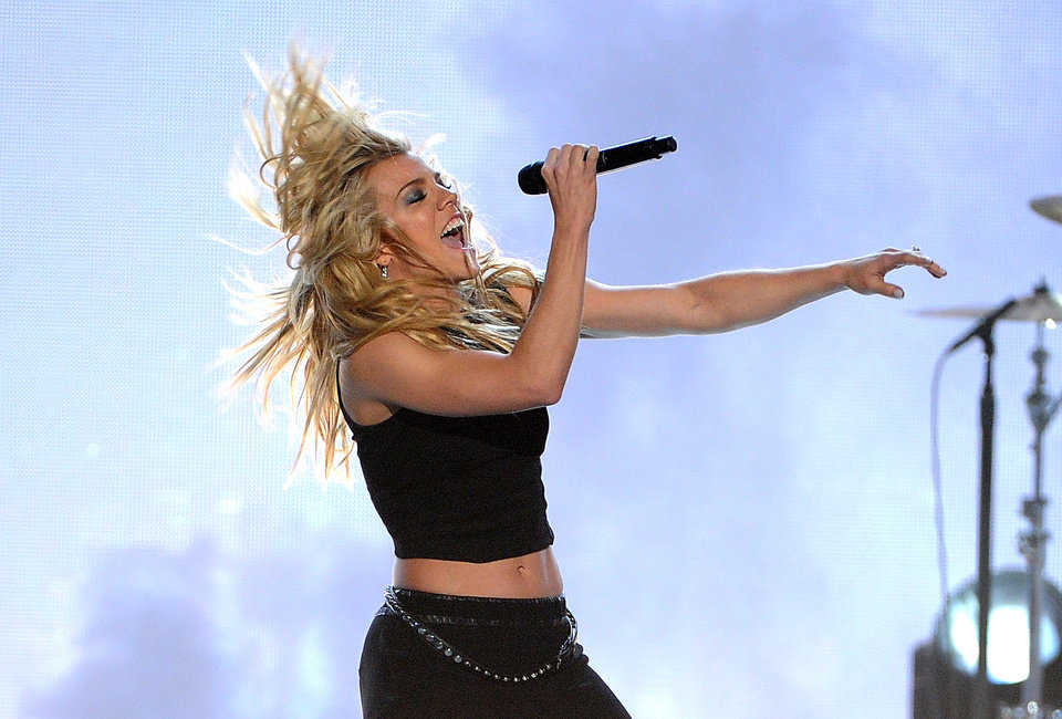 Photo - Kimberly Perry, of the musical group The Band Perry, performs at the 49th annual Academy of Country Music Awards at the MGM Grand Garden Arena on Sunday, April 6, 2014, in Las Vegas. (Photo by Chris Pizzello/Invision/AP)