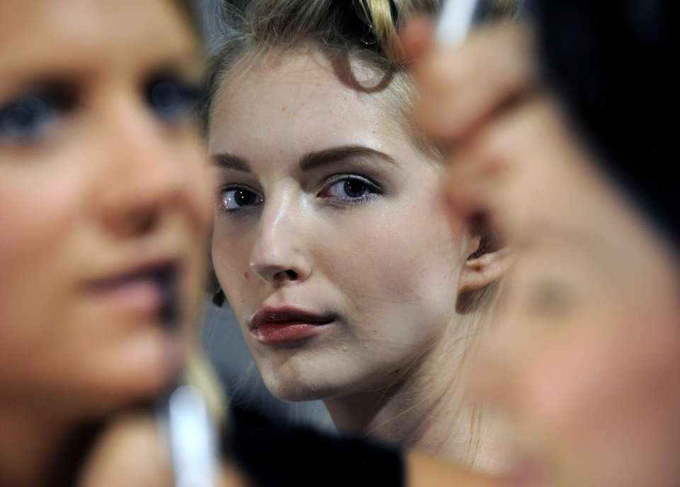 Photo -   FILE - This Sept. 7, 2012 file photo shows a model waiting backstage before the showing of the Billy Reid Spring 2013 collection during Fashion Week in New York. Tweaking your makeup routine is something you probably could do today because it's changing how you wear the products more than a change in products themselves, says Linda Wells, editor in chief of Allure. (AP Photo/Louis Lanzano, file)