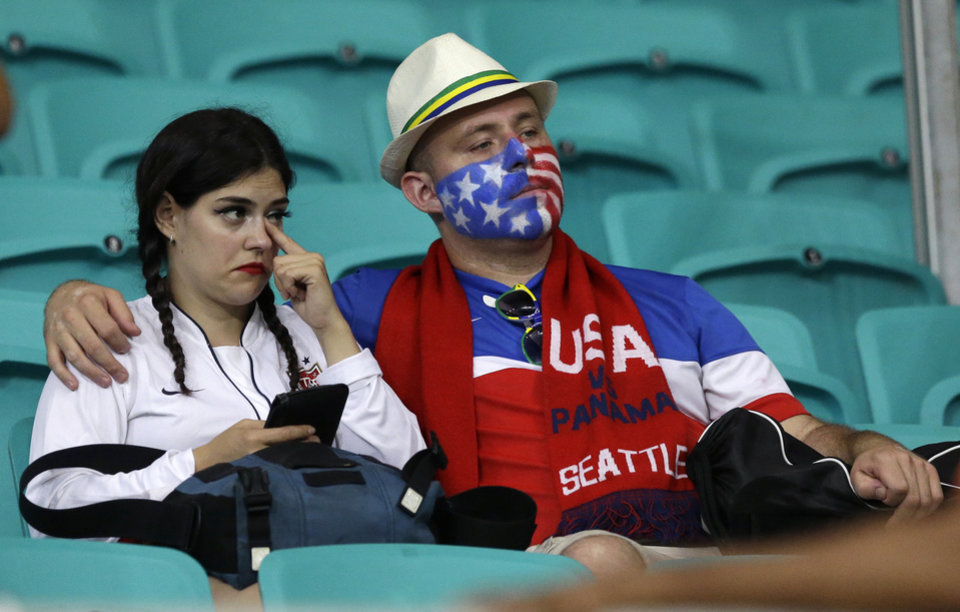 Photo - US fans sit in the stands after the World Cup round of 16 soccer match between Belgium and the USA at the Arena Fonte Nova in Salvador, Brazil, Tuesday, July 1, 2014. Belgium won the match 2-1 after extra-time. (AP Photo/Matt Dunham)