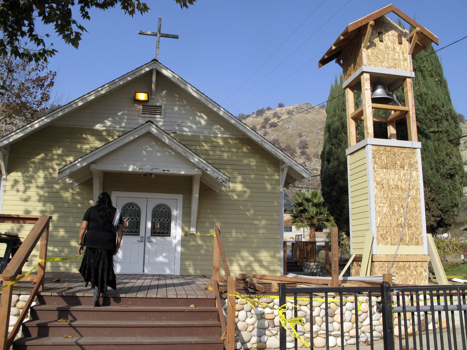 Rhoda Hunter, tribal council secretary of the Tule River Indian Reservation, walks into Mater Dolorosa Catholic Church for Mass, Sunday, Dec. 9, 2012, at the Tule River Indian Reservation in California. The church bell, its tower being renovated, has tolled throughout the day on Sunday to honor those killed in what many believe is the worst mass murder in tribal history. Hector Celaya, 31, is a suspect in shootings in which three people died and four others, including two young girls, were wounded Saturday, Dec. 8, 2012, on the reservation in the Sierra foothills of California\'s Central Valley. Since 1933 the church bell has slowly tolled to alert tribal members when someone dies.