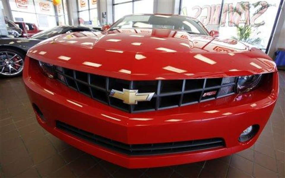 The dealership\'s first 2010 Chevy Camaro RS is on display inside the showroom at Glen Campbell Chevrolet in Williamsville, N.Y. Friday, May 15, 2009. GM says it will notify 1,100 U.S. dealers on Friday May 15, 2009 that their franchise agreements will not be renewed. (AP Photo/David Duprey)