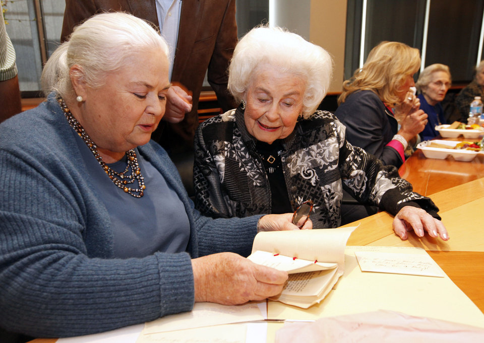 """Philomathea Club members Peg Malloy, left, and Patty Jones look at letters and booklets which were included as part of the """"Century Chest"""", which was opened on April 22, 2013, and now being read for the first time at the club's meeting at the Oklahoma History Center in Oklahoma City, OK, Friday, October 18, 2013,  Photo by Paul Hellstern, The Oklahoman"""