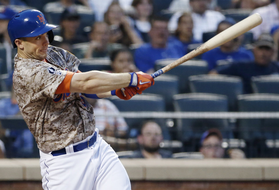 Photo - New York Mets third baseman David Wright hits a third-inning solo home run off Atlanta Braves starting pitcher Mike Minor in a baseball game in New York, Monday, July 7, 2014. (AP Photo/Kathy Willens)