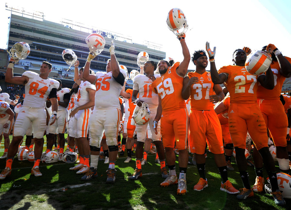 Photo - Tennessee football players, including quarter Joshua Dobbs, center, rally on the field at the end of the Orange and White game at Neyland Stadium in Knoxville, Tenn., Saturday, April 12, 2014. (AP Photo/Knoxville News Sentinel, Adam Lau)