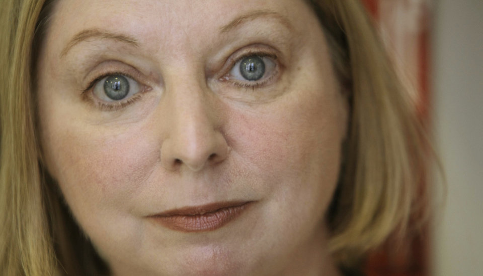 "FILE - The Booker Prize winning author Hilary Mantel poses for a photograph in London in this file photo dated Thursday, Oct. 8, 2009.  Mantel is widely criticized in the media Tuesday Feb. 19, 2013, for her ""venomous attack"" on the former Kate Middleton, the wife of Prince William, for published comments about the British public�s complex relationship with royalty quoting Mantel saying the princess is ""a jointed doll on which certain rags were hung"", and said she appeared to be designed by committee with a perfect plastic smile. (AP Photo/Alastair Grant, File)"