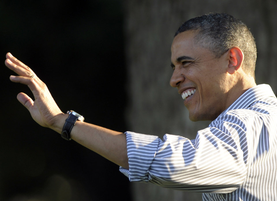 President Barack Obama waves as he arrives to speak at a Congressional picnic on the South Lawn of the White House in Washington, Wednesday, June 27, 2012. (AP Photo/Susan Walsh)