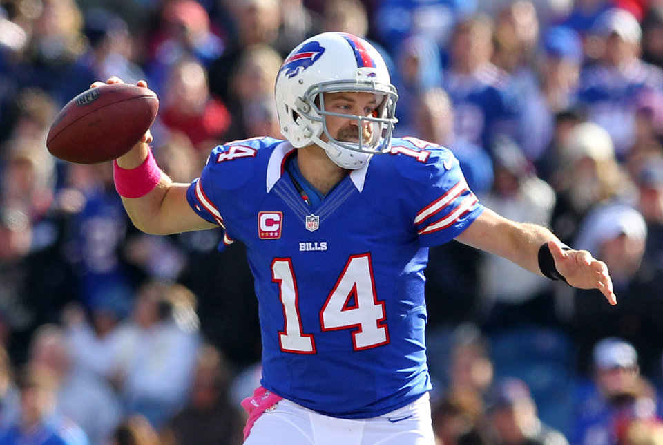 Photo -   Buffalo Bills quarterback Ryan Fitzpatrick (14) passes against the Tennessee Titans during the first half of an NFL football game in Orchard Park, N.Y., Sunday, Oct. 21, 2012. (AP Photo/Bill Wippert)