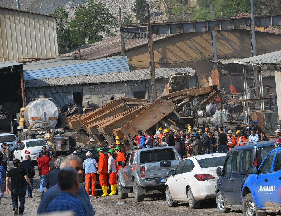 Photo - Rescue workers at the entrance of the mine after an explosion and fire at a coal mine in Soma, in western Turkey, Tuesday, May 13, 2014.  An explosion and fire at a coal mine in western Turkey killed at least one miner Tuesday and left up to 300 workers trapped underground, a Turkish official said. Twenty people were rescued from the mine in the town of Soma in Manisa province but one later died in the hospital, Soma administrator Mehmet Bahattin Atci told reporters. The town is 250 kilometers (155 miles) south of Istanbul. (AP Photo/IHA) TURKEY OUT
