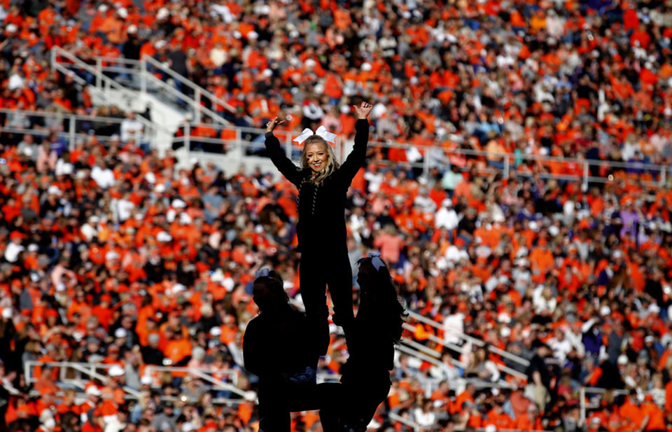 Photo - Oklahoma State cheerleaders entertain fans  during the college football game between the Oklahoma State University Cowboys and the TCU Horned Frogs at Boone Pickens Stadium in Stillwater, Okla.,  Saturday, Nov. 2, 2019. OSU won 34-27. [Sarah Phipps/The Oklahoman]