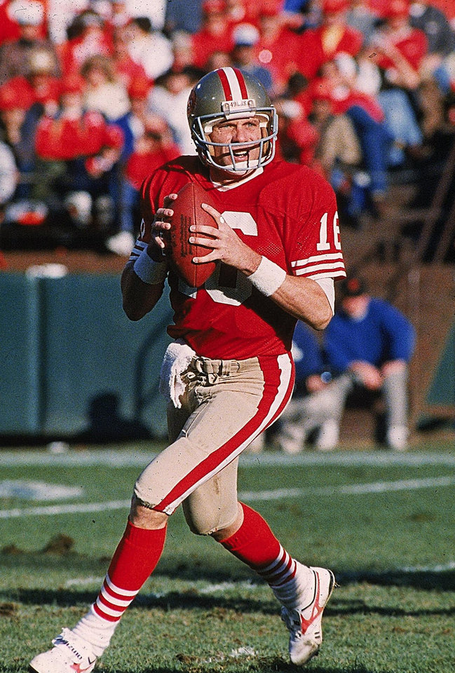Photo - FILE--     NFL FOOTBALL: San Francisco 49ers football quarterback Joe Montana carries the ball duirng the NFC divisional playoff game against the Minnesota Vikings on Jan. 1, 1989 in San Francisco. The former 49er debuted his new magazine on Monday Jan. 4, 2000. It's called Joe Montana's In the Red Zone. The first issue features stories on NFL standouts Charles Haley of the 49ers, departing Jets coach Bill Parcells and Saints coach Mike Ditka. (AP Photo/John Gaps III,file)