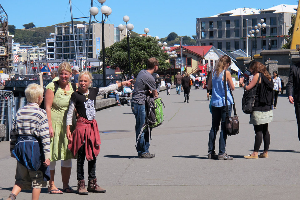 "In this Oct. 30, 2012 photo, people take advantage of fine weather to stroll along the Wellington waterfront, New Zealand. Whether you're a fan making a pilgrimage to the city where the ""The Lord of the Rings"" films were made, or you have no interest whatsoever in dwarfs and goblins, there's plenty to do in Wellington. For free. (AP Photo/Nick Perry)"