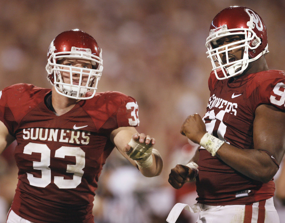 Photo - Auston English (33) and Alonzo Dotson (91) react after a pass interception during the second half of the college football game between the University of Oklahoma Sooners (OU) and the University of Missouri Tigers (MU) at the Gaylord Family Oklahoma Memorial Stadium on Saturday, Oct. 13, 2007, in Norman, Okla.  By STEVE SISNEY, The Oklahoman