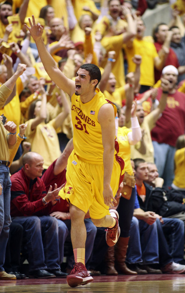 Iowa State forward Georges Niang (31) celebrates a 3-pointer during the first half of an NCAA college basketball game against Kansas, Monday, Feb. 25, 2013, in Ames, Iowa. (AP Photo/Justin Hayworth)