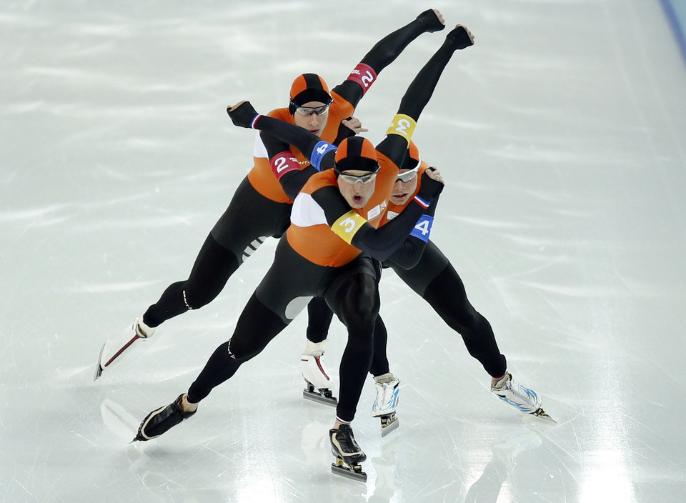 Photo - Speedskaters from team Netherlands, from top to bottom, Jan Blokhuijsen, Koen Verweij and Sven Kramer compete in the men's speedskating team pursuit quarterfinals at the Adler Arena Skating Center during the 2014 Winter Olympics in Sochi, Russia, Friday, Feb. 21, 2014.  (AP Photo/Pavel Golovkin)