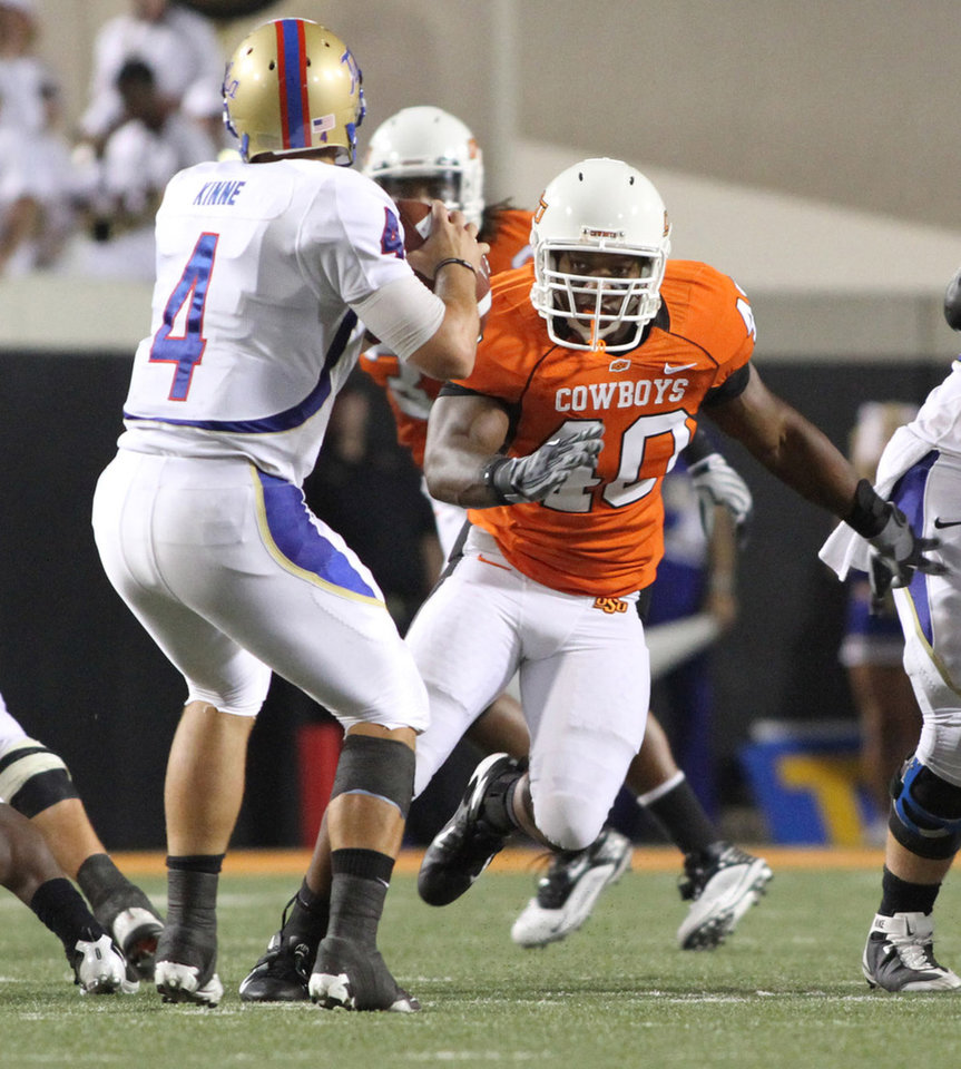 Photo - OSU's Tyler Johnson (40) during the college football game between Oklahoma State University and the University of Tulsa at Boone Pickens Stadium in Stillwater, Okla., September 18, 2010. Photo by Greg Bullard courtesy of OSU ORG XMIT: KOD
