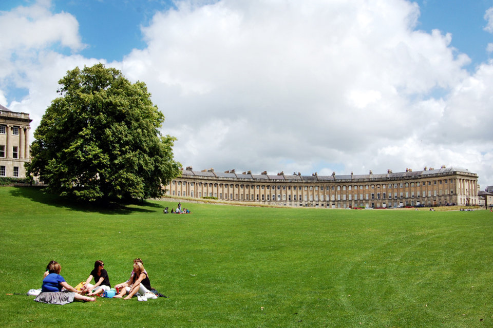 Photo -  A big, grassy park edges Bath's Royal Crescent, which contains some of England's finest Georgian homes.  (photo credit:  Rick Steves/Rick Steves' Europe)