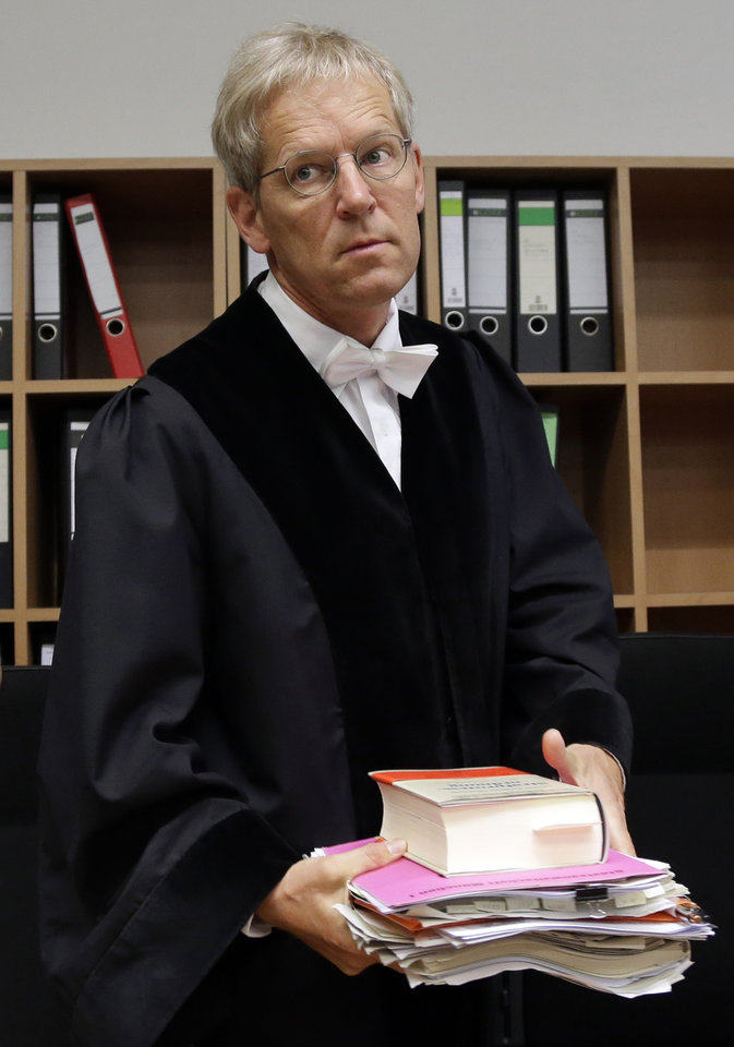 Photo - Judge Peter Noll arrives for the trial against Formula One boss Bernie Ecclestone in the regional court in Munich, southern Germany, Tuesday, Aug. 5, 2014. German prosecutors said Tuesday that they will accept closing Ecclestone's bribery trial in exchange for a $100 million payment by the Formula One boss, and judges were considering whether to end the proceedings. Ecclestone went on trial at the Munich state court in late April on charges of bribery and incitement to breach of trust — which could, if he were convicted, carry a sentence of up to 10 years in prison. (AP Photo/Matthias Schrader)