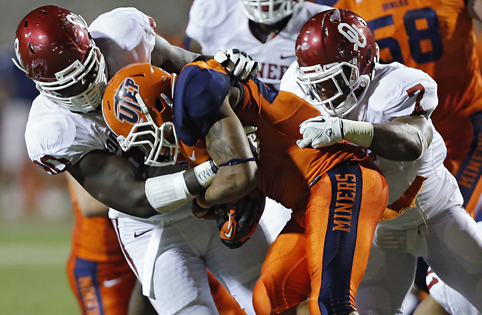 Photo - Oklahoma Sooners defensive end David King (90) and Oklahoma Sooners linebacker Corey Nelson (7) bring down UTEP's Nathan Jeffery (25) during the college football game between the University of Oklahoma Sooners (OU) and the University of Texas El Paso Miners (UTEP) at Sun Bowl Stadium on Saturday, Sept. 1, 2012, in El Paso, Tex.  Photo by Chris Landsberger, The Oklahoman