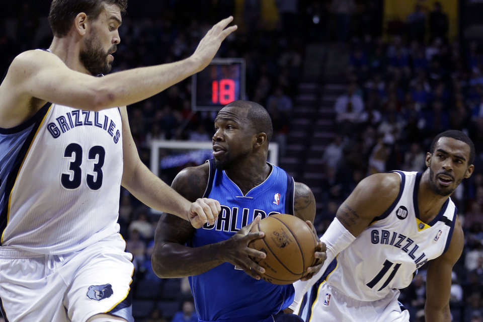 Memphis Grizzlies' Marc Gasol (33), of Spain, and Mike Conley (11) pressure Dallas Mavericks' Dominique Jones during the first half of an NBA basketball game in Memphis, Tenn., Friday, Dec. 21, 2012. (AP Photo/Danny Johnston)
