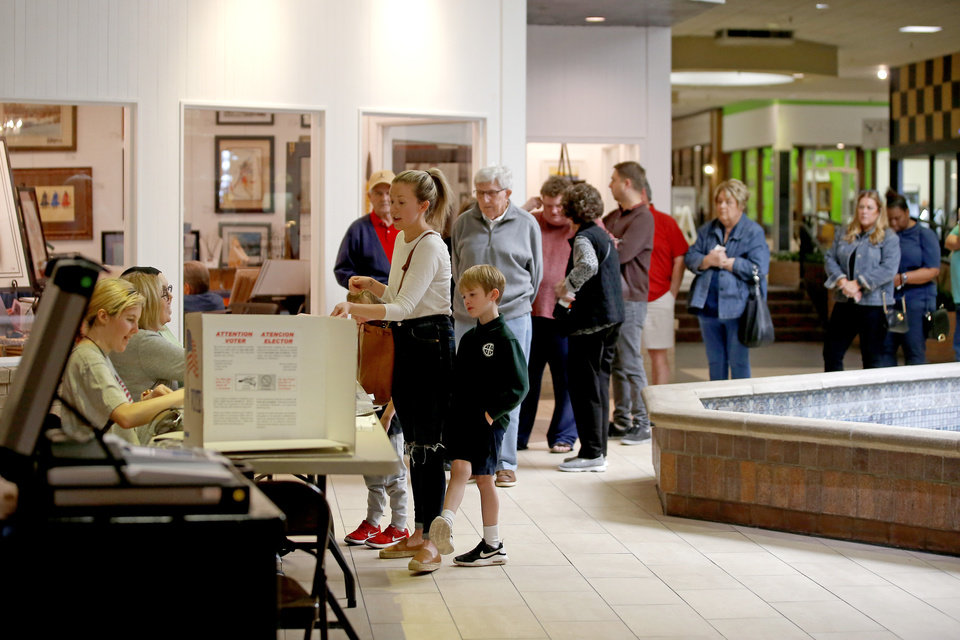 Photo - People stand in line for their ballot before voting during the Super Tuesday presidential primary election inside the Shoppes at Northpark in Oklahoma City, Tuesday, March 3, 2020. [Bryan Terry/The Oklahoman]