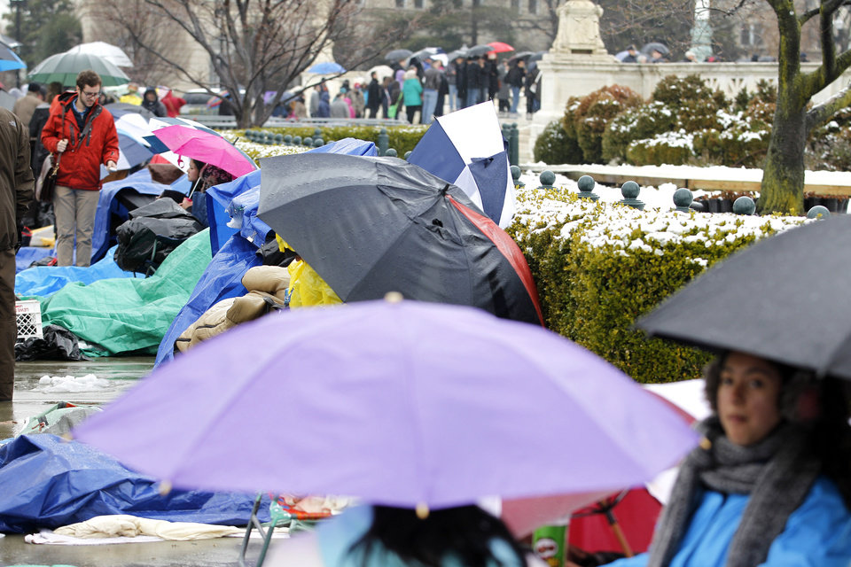 Photo - People wait in line outside of the Supreme Court in Washington, Monday March, 25, 2013, a day before the court will hear a same-sex marriage case. (AP Photo/Jose Luis Magana)