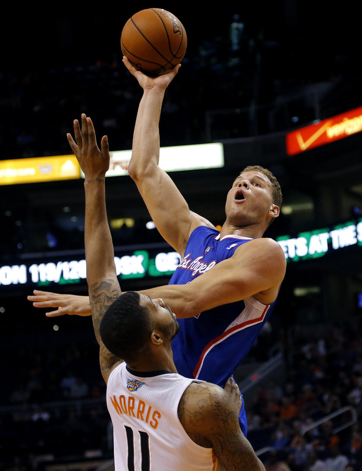 Photo - Los Angeles Clippers' Blake Griffin shoots over Phoenix Suns' Markieff Morris (11) during the first half of an NBA basketball game, Tuesday, March 4, 2014, in Phoenix. (AP Photo/Matt York)